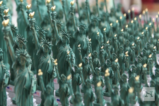 Staute of Liberty fingurines line up in Queens factory ©Rebecca